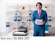 Купить «Young employee making copies at copying machine», фото № 30865397, снято 14 декабря 2018 г. (c) Elnur / Фотобанк Лори