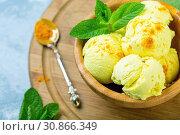 Купить «Golden ice cream with turmeric closeup», фото № 30866349, снято 31 мая 2019 г. (c) Марина Сапрунова / Фотобанк Лори