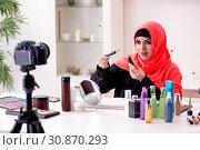 Купить «Beauty blogger in hijab recording video for her blog», фото № 30870293, снято 5 февраля 2019 г. (c) Elnur / Фотобанк Лори