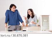 Купить «Young couple in budget planning concept», фото № 30870381, снято 22 января 2019 г. (c) Elnur / Фотобанк Лори