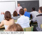 Купить «Confident lecturer talking to mixed age students», фото № 30871313, снято 28 июня 2018 г. (c) Яков Филимонов / Фотобанк Лори