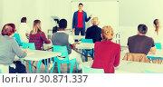 Купить «Male teacher lecturing to students», фото № 30871337, снято 8 мая 2018 г. (c) Яков Филимонов / Фотобанк Лори