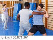 Купить «Two men practicing self defense techniques», фото № 30871361, снято 31 октября 2018 г. (c) Яков Филимонов / Фотобанк Лори