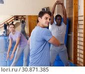 Купить «People warming up at gym», фото № 30871385, снято 31 октября 2018 г. (c) Яков Филимонов / Фотобанк Лори