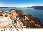Купить «View of the city of Oia on the island of Santorini in Greece», фото № 30871877, снято 8 июня 2017 г. (c) Наталья Волкова / Фотобанк Лори