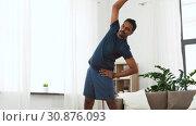 Купить «indian man exercising and leaning at home», видеоролик № 30876093, снято 27 мая 2019 г. (c) Syda Productions / Фотобанк Лори