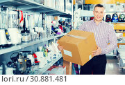 Купить «Man with packed purchases in household appliances section in shop», фото № 30881481, снято 1 марта 2018 г. (c) Яков Филимонов / Фотобанк Лори