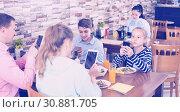 Купить «Family phubbing in cafe», фото № 30881705, снято 10 апреля 2017 г. (c) Яков Филимонов / Фотобанк Лори
