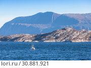 Купить «Small fishing boat is in Norwegian sea near coastal mountains, Trondheim region, Norway», фото № 30881921, снято 17 октября 2016 г. (c) EugeneSergeev / Фотобанк Лори