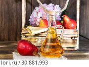 Купить «Food, vegetarianism, healthy diet food, drink. Natural juice without pulp from fresh red pear in a glass decanter, wine, liqueur and seasonal fruit harvest in a wooden box on the table», фото № 30881993, снято 2 июня 2019 г. (c) Светлана Евграфова / Фотобанк Лори
