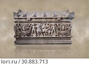 Side panel of a Roman relief garland sculpted sarcophagus, style typical of Pamphylia, 3rd Century AD, Konya Archaeological Museum, Turkey. Against a warm art background. (2018 год). Редакционное фото, фотограф Funkystock / age Fotostock / Фотобанк Лори