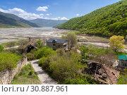 Купить «Ananuri village with Zhinvali lake», фото № 30887961, снято 30 апреля 2019 г. (c) EugeneSergeev / Фотобанк Лори