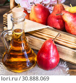 Купить «Food, vegetarianism, healthy diet food, drink. Natural juice without pulp from fresh red pear in a glass decanter, wine, liqueur and seasonal fruit harvest in a wooden box on the table», фото № 30888069, снято 2 июня 2019 г. (c) Светлана Евграфова / Фотобанк Лори