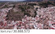 Купить «Aerial view of Sagunto city and antique roman fortress, Valencia, Spain», видеоролик № 30888573, снято 19 марта 2019 г. (c) Яков Филимонов / Фотобанк Лори