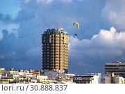 Купить «Paraglider at the coastline of Las Palmas, Canary Islands.», фото № 30888837, снято 26 марта 2019 г. (c) age Fotostock / Фотобанк Лори