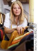 Купить «Woman choosing leather jacket», фото № 30892757, снято 5 сентября 2018 г. (c) Яков Филимонов / Фотобанк Лори