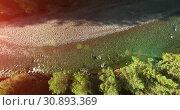 Купить «Mid air flight over fresh and clean mountain river at sunny summer morning. Vertical movement», видеоролик № 30893369, снято 26 мая 2017 г. (c) Александр Маркин / Фотобанк Лори