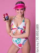 Chelyabinsk/Russia - April 12, 2019; Sexy woman in a swimsuit holding a Pepsi jar. Редакционное фото, фотограф Женя Канашкин / Фотобанк Лори