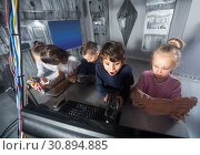 Купить «children play in the quest room of a inscrutable bunker», фото № 30894885, снято 21 октября 2017 г. (c) Яков Филимонов / Фотобанк Лори