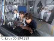 Купить «Children playing in bunker quest room», фото № 30894889, снято 21 октября 2017 г. (c) Яков Филимонов / Фотобанк Лори