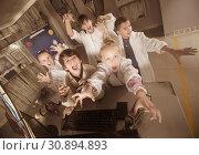 Купить «Children rest in the quest room game bunker», фото № 30894893, снято 21 октября 2017 г. (c) Яков Филимонов / Фотобанк Лори