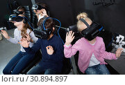 Купить «Enthusiastic children in virtual reality glasses in quest room», фото № 30894897, снято 21 октября 2017 г. (c) Яков Филимонов / Фотобанк Лори