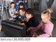 Купить «Children playing in bunker questroom», фото № 30895009, снято 21 октября 2017 г. (c) Яков Филимонов / Фотобанк Лори