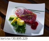 Купить «Delicious pieces raw tuna, green avocado and greens at plate», фото № 30895229, снято 25 июня 2019 г. (c) Яков Филимонов / Фотобанк Лори