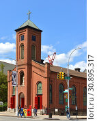 Купить «St. Joseph of Holy Family Church oldest existing church in Harlem, Нью-Йорк, США», фото № 30895317, снято 9 мая 2019 г. (c) Валерия Попова / Фотобанк Лори