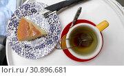 Cup of tea with cake. Стоковое видео, видеограф Ekaterina Demidova / Фотобанк Лори