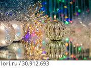 Купить «Christmas decorations with candle and silver balls on the mirror.», фото № 30912693, снято 27 декабря 2014 г. (c) easy Fotostock / Фотобанк Лори