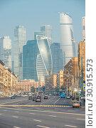 Купить «Landmark Moscow-Moscow City and city streets with cars», фото № 30915573, снято 26 июля 2016 г. (c) easy Fotostock / Фотобанк Лори
