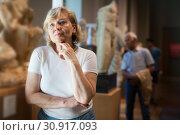 Купить «Mature woman visiting exposition», фото № 30917093, снято 12 мая 2019 г. (c) Яков Филимонов / Фотобанк Лори