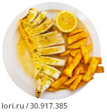Купить «Fried squid served with baked potatoes», фото № 30917385, снято 12 декабря 2019 г. (c) Яков Филимонов / Фотобанк Лори