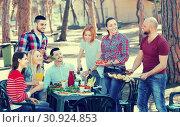 Купить «Friends relaxing at grill party», фото № 30924853, снято 17 июня 2019 г. (c) Яков Филимонов / Фотобанк Лори