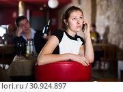 Unhappy woman talking on phone. Стоковое фото, фотограф Яков Филимонов / Фотобанк Лори