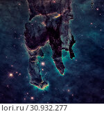 Купить «The Pillars of Creation. The Eagle Nebula or M16 or NGC 6611 is a young open cluster of stars in the constellation Serpens. Retouched image with small DOF. Elements of this image furnished by NASA.», фото № 30932277, снято 23 июля 2019 г. (c) easy Fotostock / Фотобанк Лори
