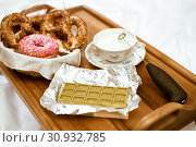 Купить «Focus on green chocolate with the Chinese matcha tea, antique porcelain cup with whipped cream and pretzels with iced donuts», фото № 30932785, снято 9 февраля 2019 г. (c) katalinks / Фотобанк Лори