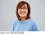 Купить «portrait of senior woman in glasses over grey», фото № 30933085, снято 8 февраля 2019 г. (c) Syda Productions / Фотобанк Лори