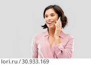 Купить «young woman in striped shirt calling on smartphone», фото № 30933169, снято 6 марта 2019 г. (c) Syda Productions / Фотобанк Лори