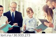 Купить «business team with tablet pc and folders at office», фото № 30933273, снято 3 июля 2016 г. (c) Syda Productions / Фотобанк Лори