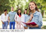 Купить «teenage student girl with diary or notebook», фото № 30933317, снято 17 февраля 2019 г. (c) Syda Productions / Фотобанк Лори