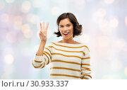 Купить «happy smiling woman showing three fingers», фото № 30933337, снято 6 марта 2019 г. (c) Syda Productions / Фотобанк Лори