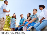 Купить «happy international friends talking in city», фото № 30933409, снято 10 июня 2018 г. (c) Syda Productions / Фотобанк Лори
