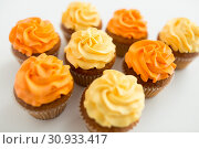Купить «cupcakes with frosting on white background», фото № 30933417, снято 6 июля 2018 г. (c) Syda Productions / Фотобанк Лори