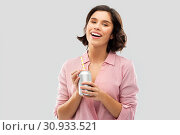 Купить «woman drinking soda from can with paper straw», фото № 30933521, снято 6 марта 2019 г. (c) Syda Productions / Фотобанк Лори