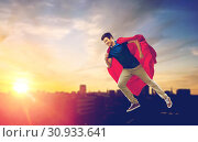 Купить «man in superhero cape flying over sunset in city», фото № 30933641, снято 3 февраля 2019 г. (c) Syda Productions / Фотобанк Лори