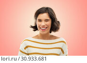 Купить «happy smiling woman in striped pullover winking», фото № 30933681, снято 6 марта 2019 г. (c) Syda Productions / Фотобанк Лори
