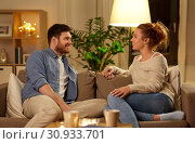 Купить «happy couple talking at home in evening», фото № 30933701, снято 5 января 2019 г. (c) Syda Productions / Фотобанк Лори