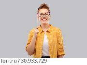 Купить «smiling red haired teenage girl with big glasses», фото № 30933729, снято 28 февраля 2019 г. (c) Syda Productions / Фотобанк Лори
